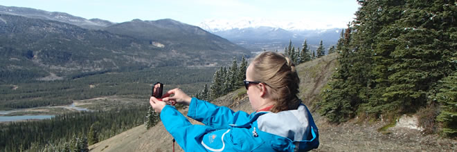 Taking a Compass Bearing on a Navigation Course in the Mountians
